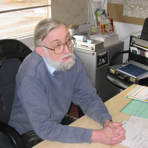 roger goldfinch at his desk